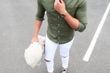 13 an olive green shirt, ripped white jeans and chucks