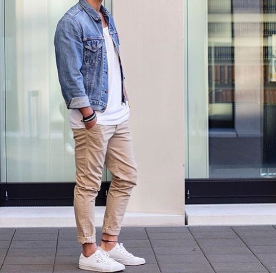 beige pants, a white tee, a denim jacket and white sneakers