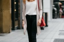 13 black denim, a white top, a blush cardigan and black heels