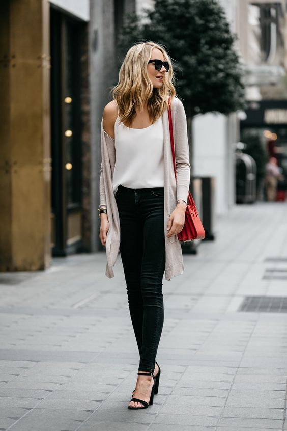 black denim, a white top, a blush cardigan and black heels