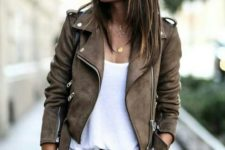 13 black jeans, a white tee and a brown suede jacket