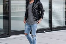 13 distressed denim, a grey tee, a black moto jacket and white sneakers