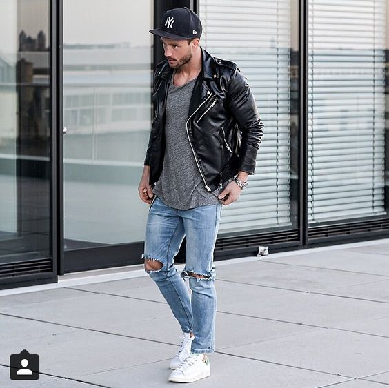 distressed denim, a grey tee, a black moto jacket and white sneakers