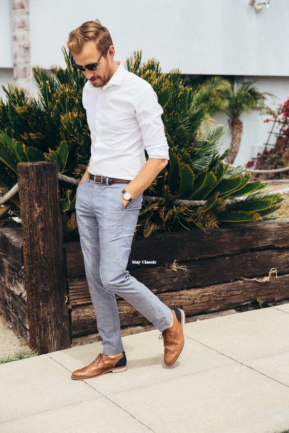 grey pants, a white shirt and brown leather shoes