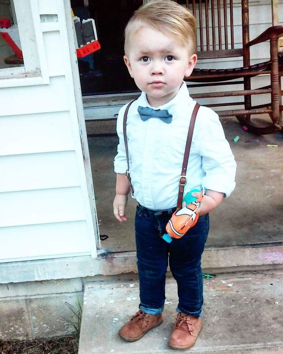 navy jeans, a mint shirt, a blue bow tie and brown shoes