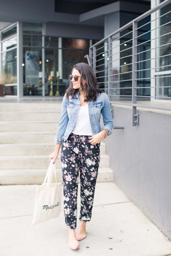 pink lace up flats, floral print pants, a white tee and a denim jacket