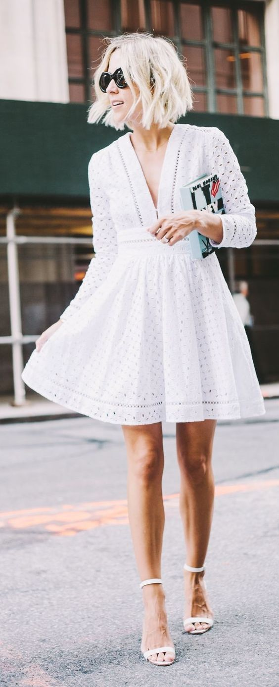 a little white eyelet dress with half sleeves and white heels