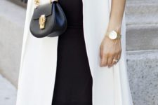 14 a navy dress, a long white vest and nude flats for perfect style