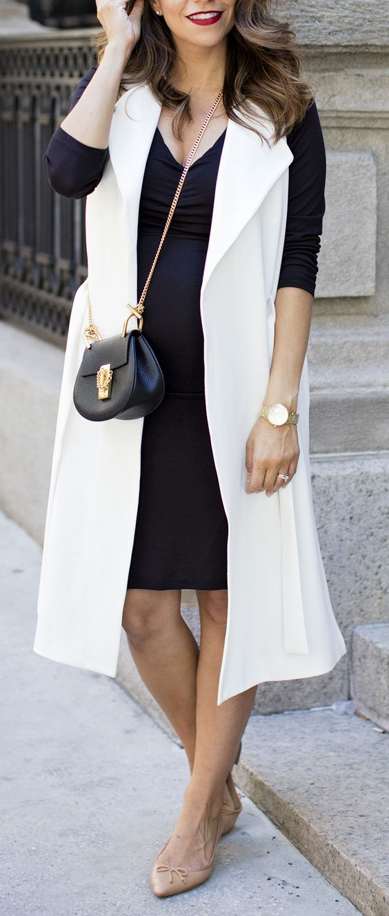 a navy dress, a long white vest and nude flats for perfect style