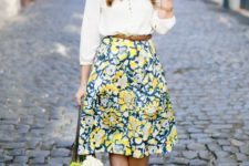 14 a white shirt, a bold yellow and green knee skirt and nude pumps