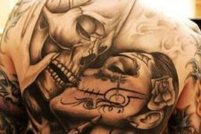 14 a whole back tattoo with a skull and a girl kissing