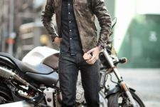14 black jeans, a chambray shirt, a brown leather jacket and yellow sneakers