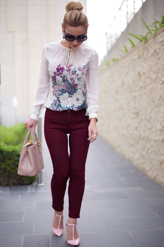 burgundy trousers, a floral blouse, pink heels