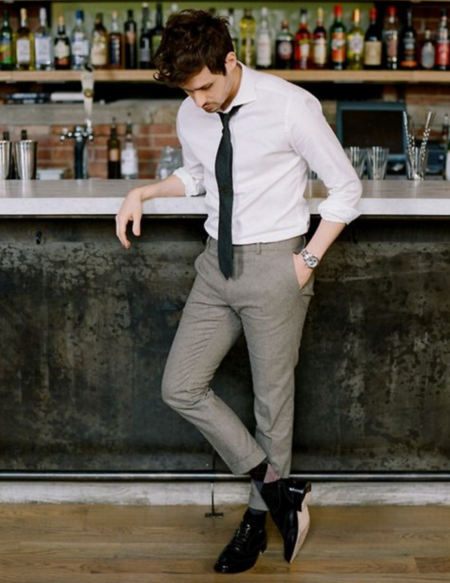 grey pants, a white shirt, a black tie and shoes