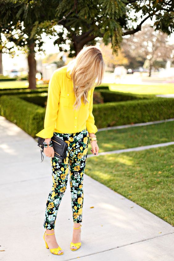a bold yellow shirt, bold floral pants and yellow shoes