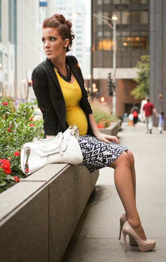 a patterned skirt, a yellow top, a black jacket and nude heels