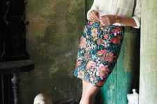 15 an ivory v-neck blouse, a floral over the knee skirt and blush shoes