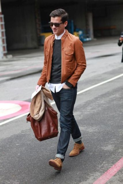 navy jeans, a shirt and a pullover, an ocher jacket and shoes
