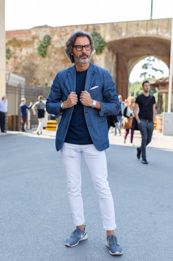 white jeans, a blue tee, a blue blazer and blue chucks