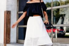 16 a black off the shoulder, a white perforated midi skirt, black lace up heels