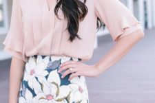 a blush short sleeve blouse and a floral pencil skirt