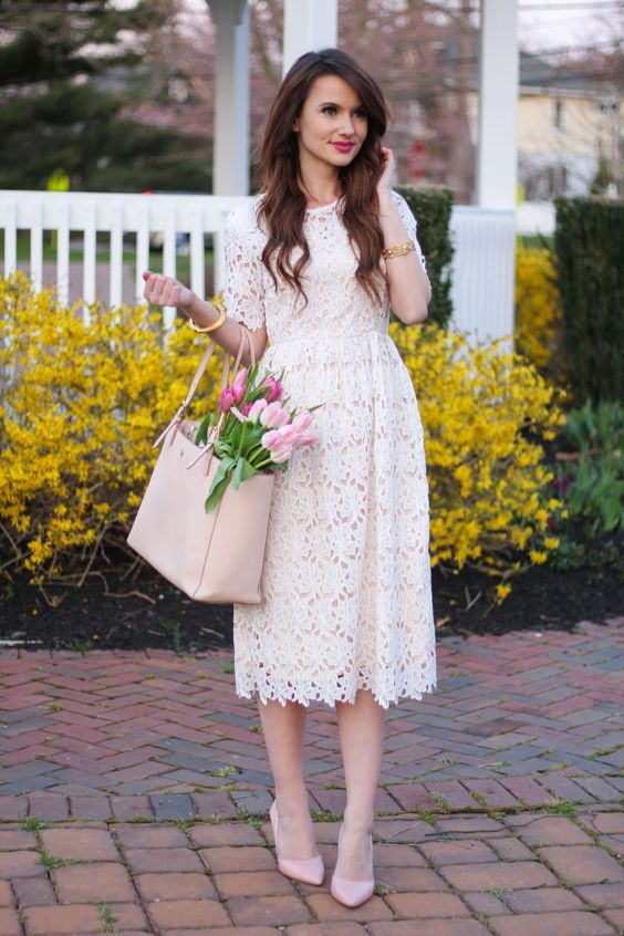 a white lace midi dress and pink heels