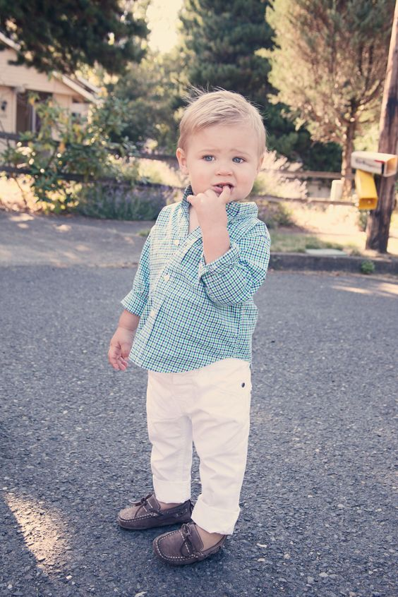white jeans, a checked blue shirt and brown moccasins