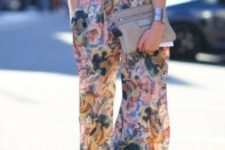 17 a white blouse with half sleeves, wide floral pants and grey suede shoes
