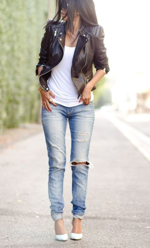 blue ripped jeans, a black leather jacket, a white top and heels