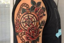 17 colorful compass tattoo with roses on an arm