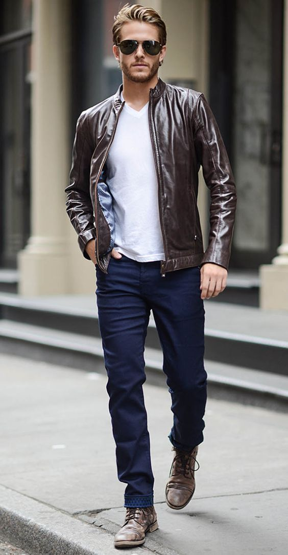casual look suitable for work with navy jeans, a white tee, a brown leather jacket and boots