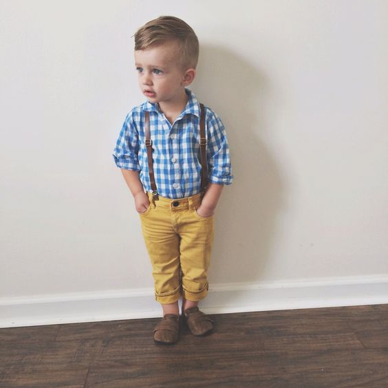 stylish little boy outfit with yellow jeans, a plaid shirt, suspenders and brown moccasins for country style
