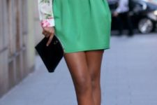 18 a green mini skirt, a floral blouse and black heels
