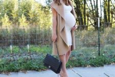 18 long brown sleeveless cardigan, an ivory dress and blush heels