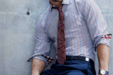 18 navy pants, a striped blue and red shirt and a burgundy pattern tie