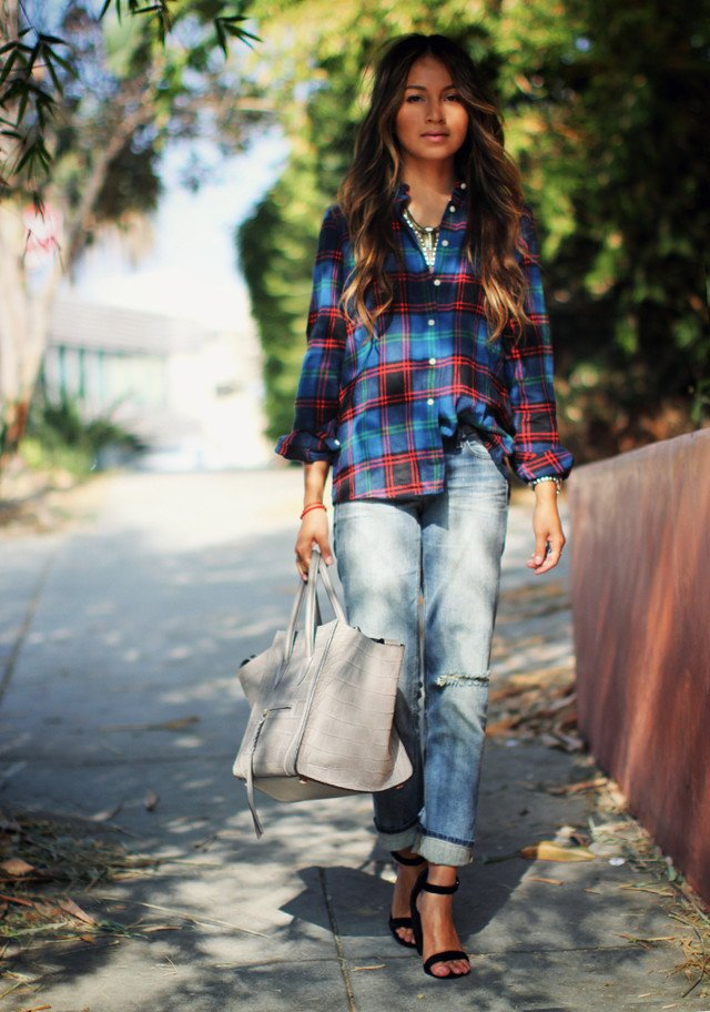 ripped jeans, a plaid shirt and black heels