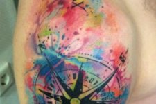 18 watercolor compass tattoo on a shoulder