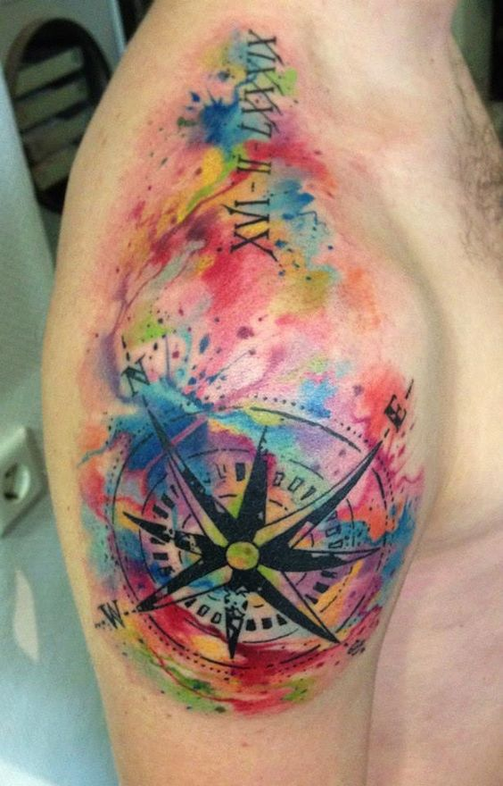watercolor compass tattoo on a shoulder