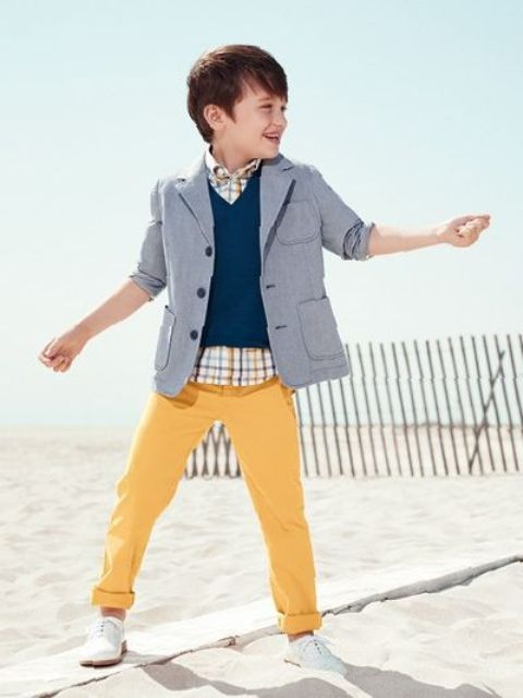 stylish boy outfit with yellow pants, a checked shirt, a navy vest, a grey jacket
