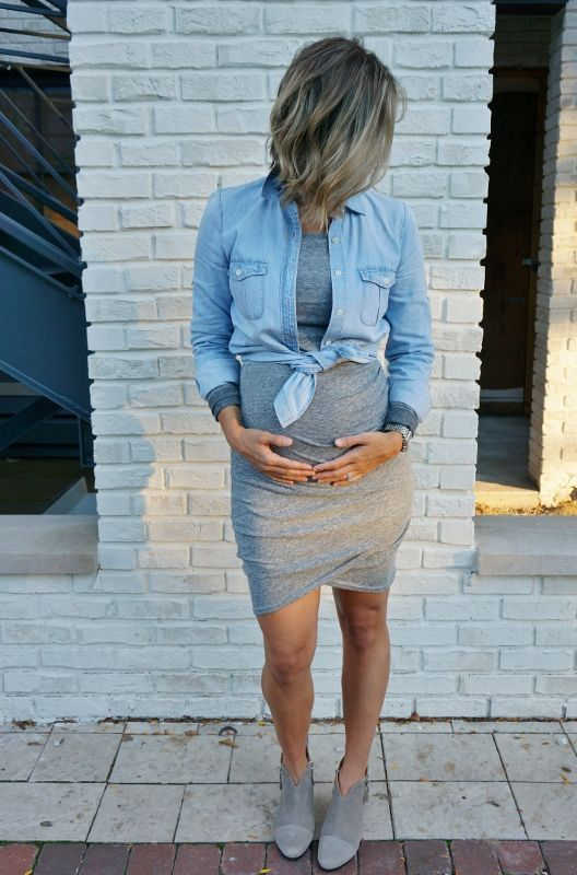 a grey dress, grey suede boots and a denim jacket