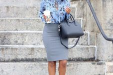 19 a grey knee skirt, a blue floral blouse and black shoes