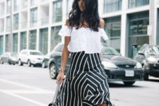 19 black and white striped skirt, a white off the shoulder, black heels