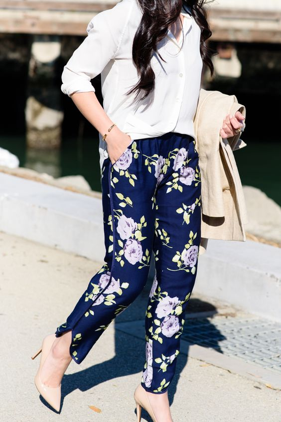 navy floral print pants, a white shirt and nude heels