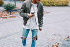 19 ripped jeans, a grey tee and a denim jacket, an olive green jacket and white Converse