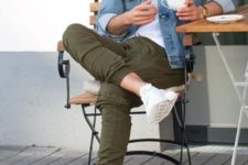 20 a denim jacket, a white t-shirt, olive green pants, white sneakers