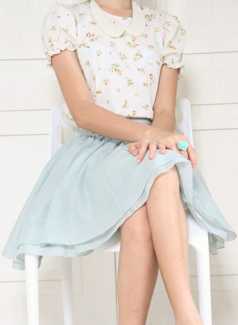 a mint skirt and a retro floral blouse with ruffled sleeves