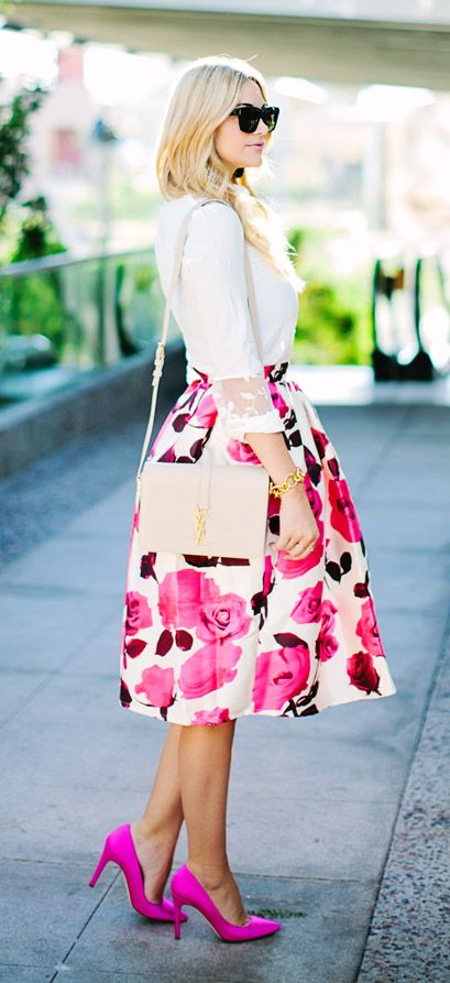 a white blouse with lace sleeves, a pink floral midi skirt, hot pink heels