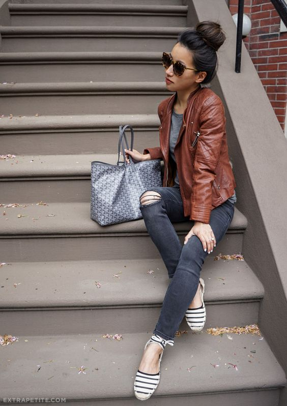 dark grey ripped jeans, a grey tee, striped flats and a cognac leather jacket