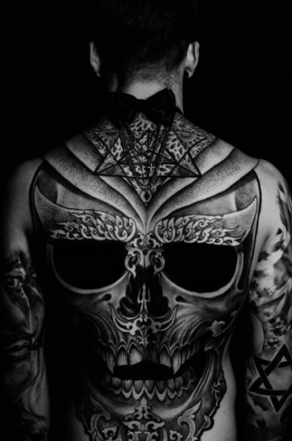gorgeous black and white skull tattoo that takes the entire back and upper arms