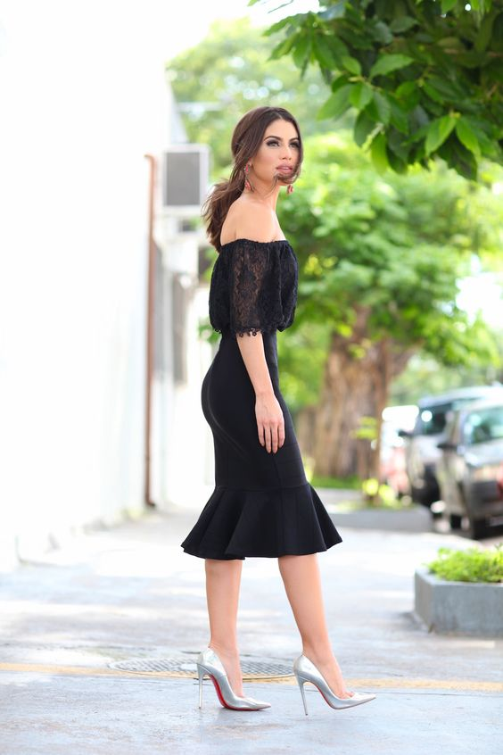 silver heels, a black lace off the shoulder, a black pencil skirt with ruffles